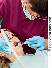 Dentist working patient