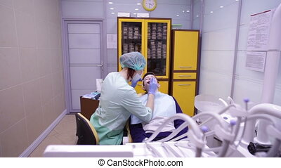 Dentistry. A doctor examines a teeth teenager
