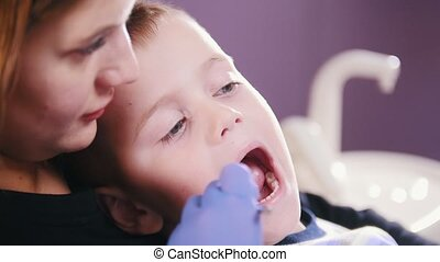 Dentistry. Dentist examines the oral cavity of the kid....