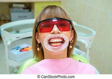 dentistry happy patient in the chair in goggles