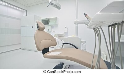 Modern dentistry medical room interior with special equipment, inscriptions on cabinet are not trademarks or other subjects of copyright