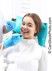 Dentistry, plucking, chiselling car - Woman at the dentist's...