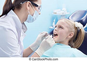 Dentistry - The dentist treats teeth patient