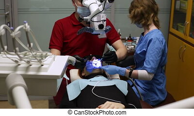 Dentistry under the microscope - The dentist treats teeth...
