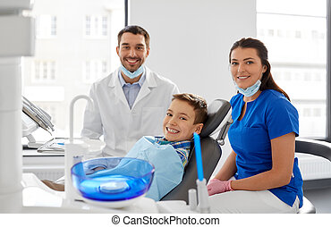 dentists and kid patient at dental clinic