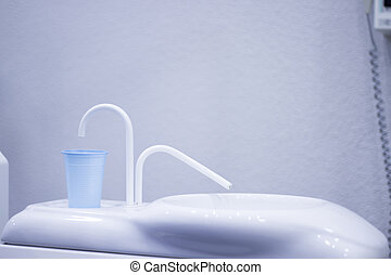 Dentist's chair and mouth rinse cup - Dentist's chair and...