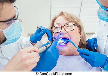 Dentists hardening toot crown with UV light