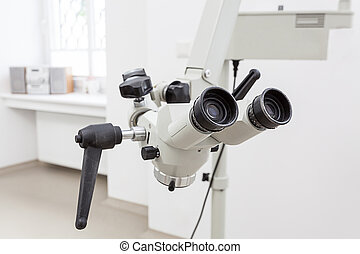 Dentist's microscope - Closeup of a dentist microscope for a...