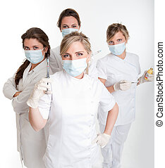 Dentists - Four female dentists posing with masks and...