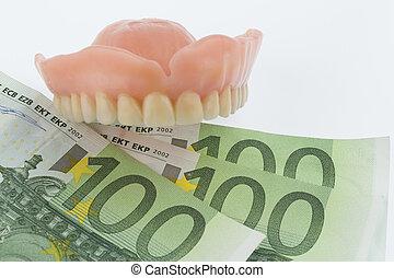 dentition and euro bills - denture and euro bills, symbol...