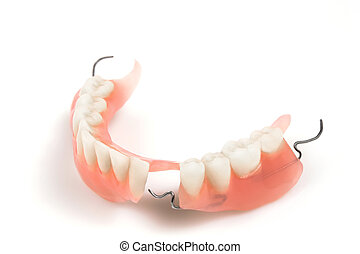 Denture - Lower denture with braces on a white background. ...
