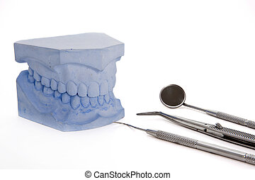 Denture molds and tools - Denture molds with dental tools...