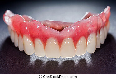 Denture - The artificial denture on isolated black ...