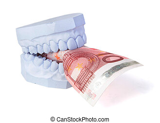 Dentures cost - A set of teeth with some money. All isolated...
