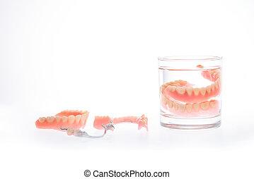 Dentures in glass of water
