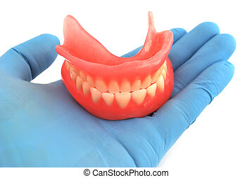 dentures in hand - dentures in his hand on a white...