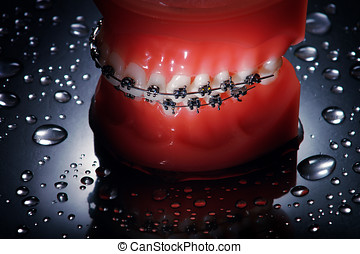 Dentures with braces waterdrops background