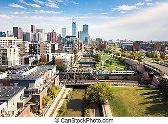 Denver cityscape aerial view with bridges over cherry creek river