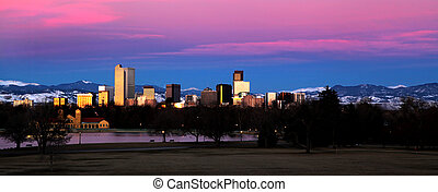 Denver, Colorado skyline with the Rocky Mountains in the foreground at dawn
