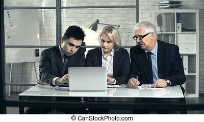 Department Briefing - Front view of three business people...