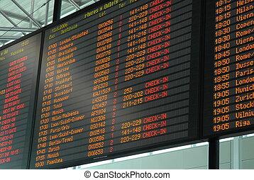 departure board - large illuminated airport departure board...