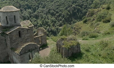 Departure on a drone over the ancient dilapidated Christian...
