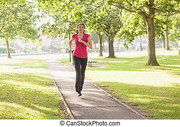 deportivo, mujer que corre, en, un, parque