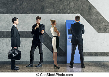 Deposit concept - Businesspeople queing to use blue ATM...