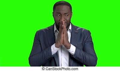Depressed Afro-American businessman on green screen....