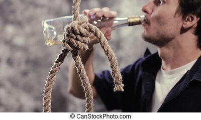 Depressed alcoholic drunkard suicide with rope, alcohol...