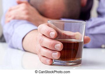 Depressed alcoholic - A closeup of a depressed alcoholic...