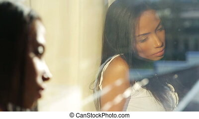 Depressed Beautiful Woman Look Out of Window