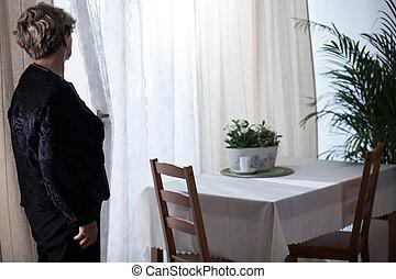 Depressed bereaved female yearning husband