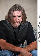 Depressed Biker Gang Member - Exhausted biker gang man...