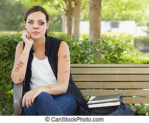 Depressed Bruised and Battered Young Woman on Bench