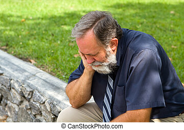 Depressed Businessman - Businessman depressed by economic...