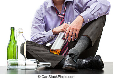 Depressed businessman drinking alcohol
