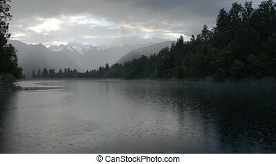 Depressed cloudscape and strong rain over the Lake Matheson