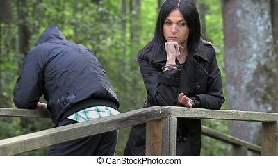 Depressed couple in the park