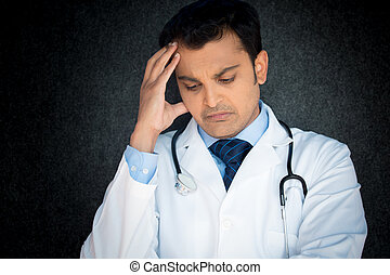Depressed doctor - Closeup portrait, young depressed man...