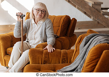 Depressed elderly woman looking at the empty space near her