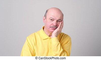 Depressed european senior man having bad mood. He is bored...
