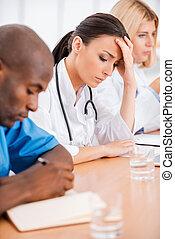 Depressed female doctor.