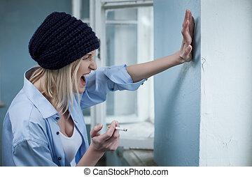 Depressed female drug addict is expressing negative feelings...