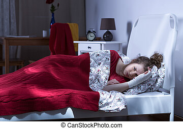 Depressed female lying in bed