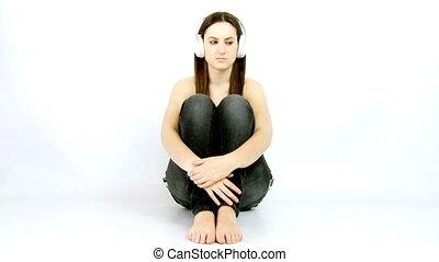 Depressed girl listening music