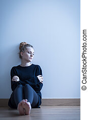Depressed girl sitting