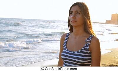 Depressed girl thinking at beach