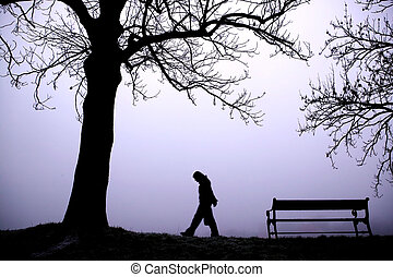 Depressed in Fog - A person walking alone in thick fog.