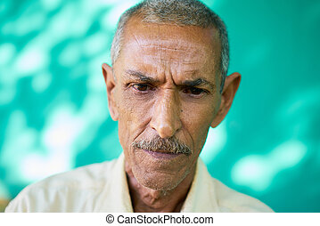 Depressed Latino Old Man With Sad Worried Face Expression